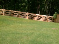 Cross Buck Fencing Adjacent to Cedar Cap & Trim